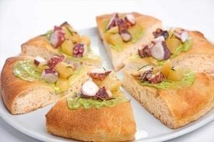 Gourmet focaccia made with stone ground flour with octopus and potatoes