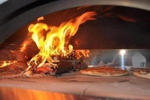 Video tutorial for cooking pizza in a home wood-burning oven
